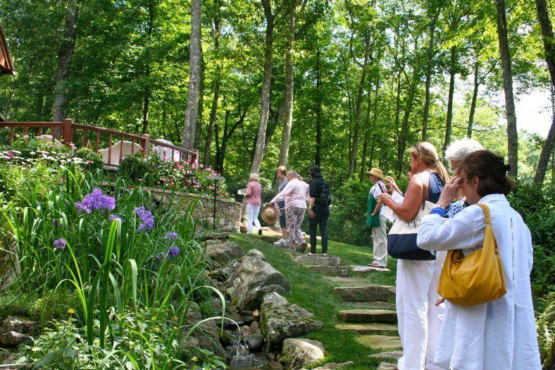 women on garden tour through jackson county