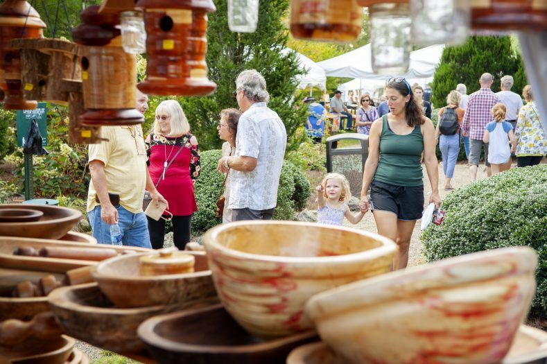 people walking around looking at pottery at leaf festival in jackson county