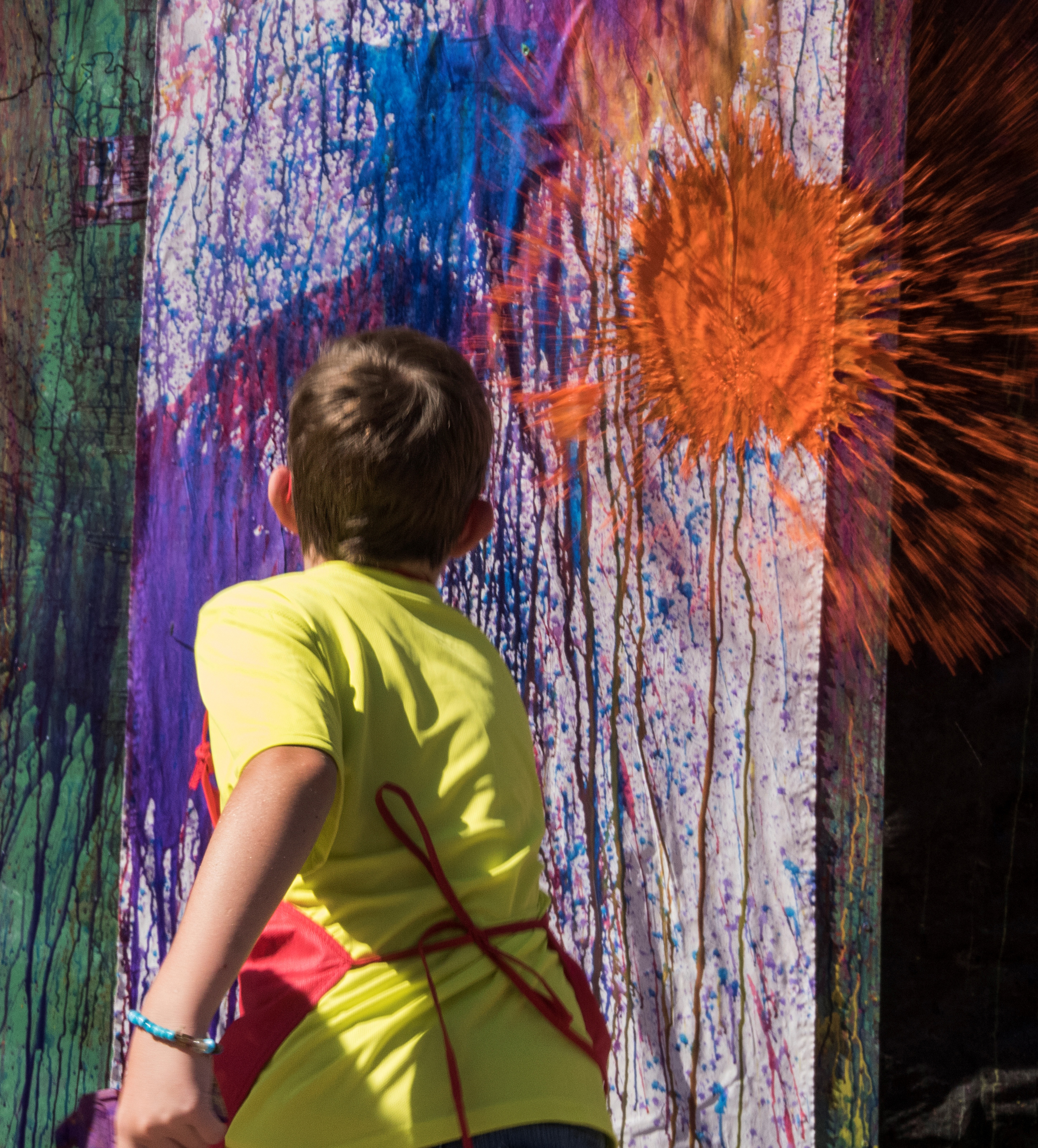 boy throwing paint and making art in jackson county