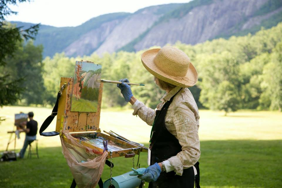 woman painting the view from lonesome valley in jackson county