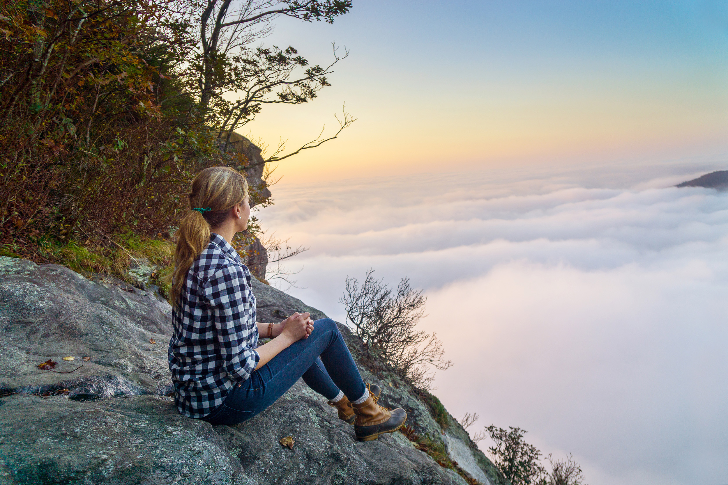woman resting after hiking whit side mountain and taking in the cloudy view of jackson county