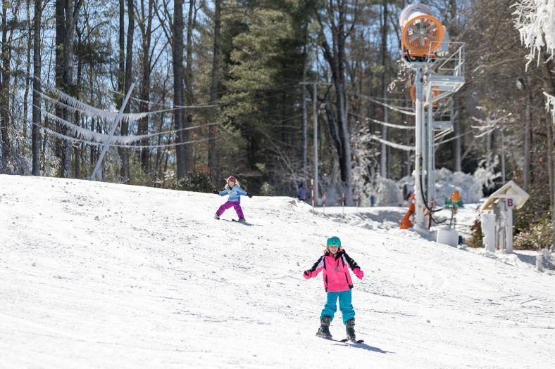 girls skiing the slopes of sapphire valley in jackson county