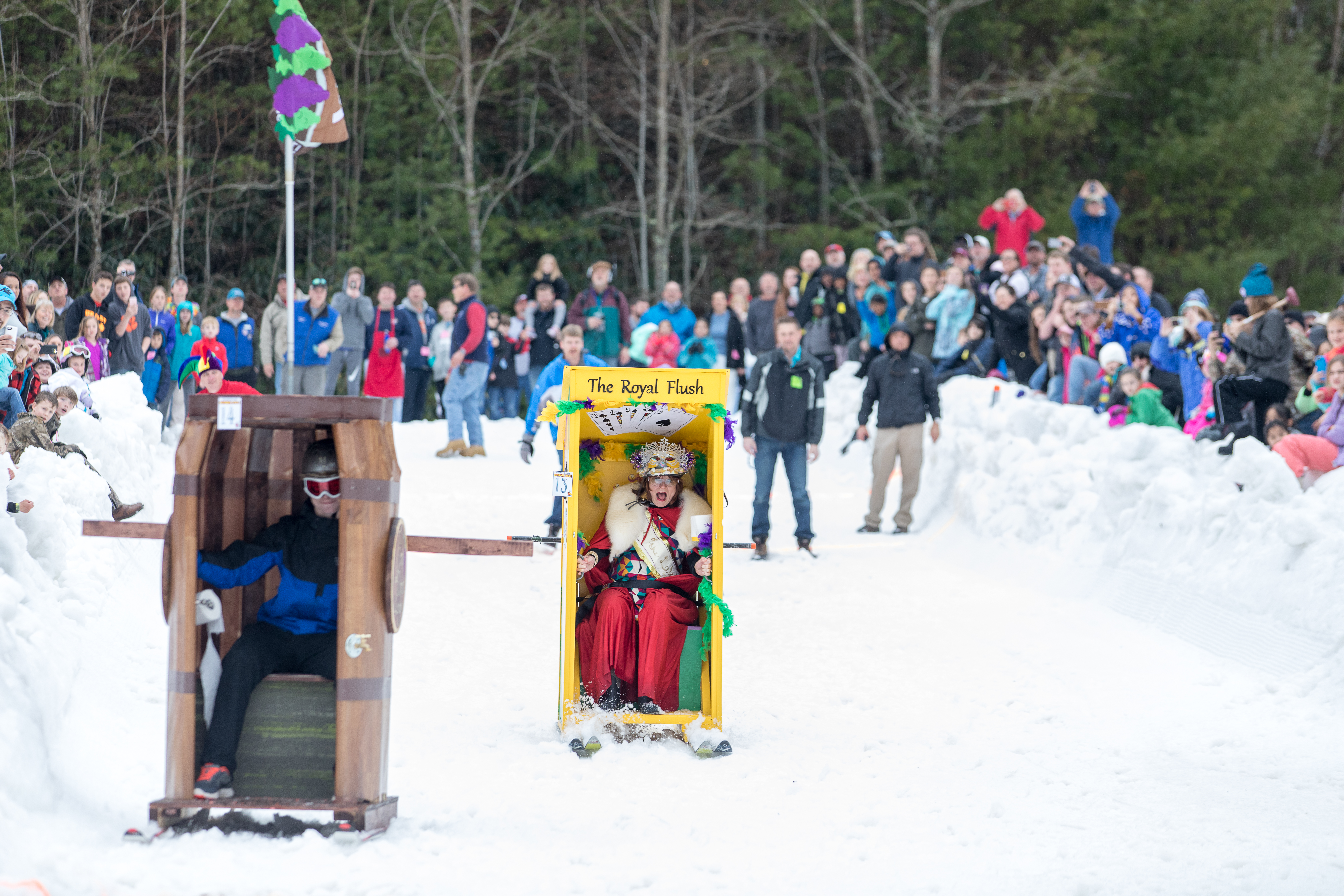 people having fun and watching the outhouse races in jackson county