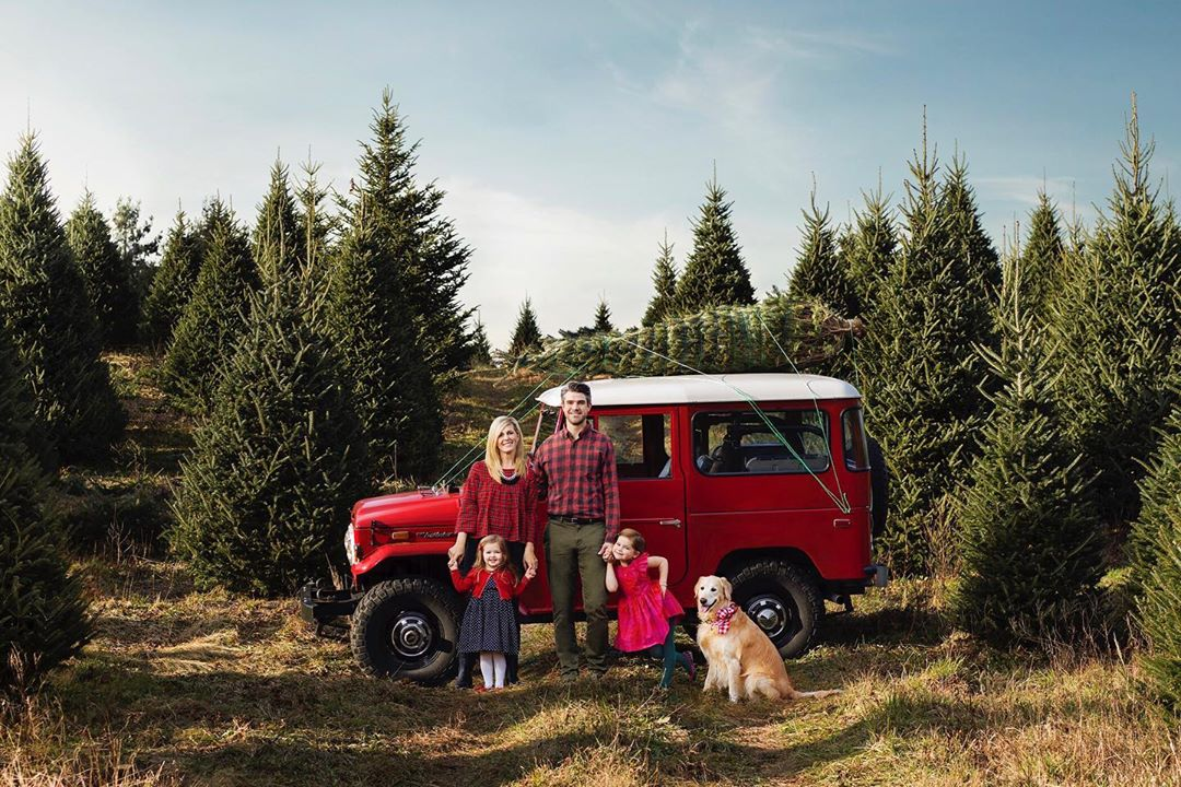 family with their dog picking out the perfect Christmas tree in jackson county