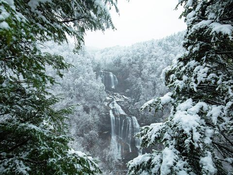 waterfall surrounded by heavy snowfall in jackson county