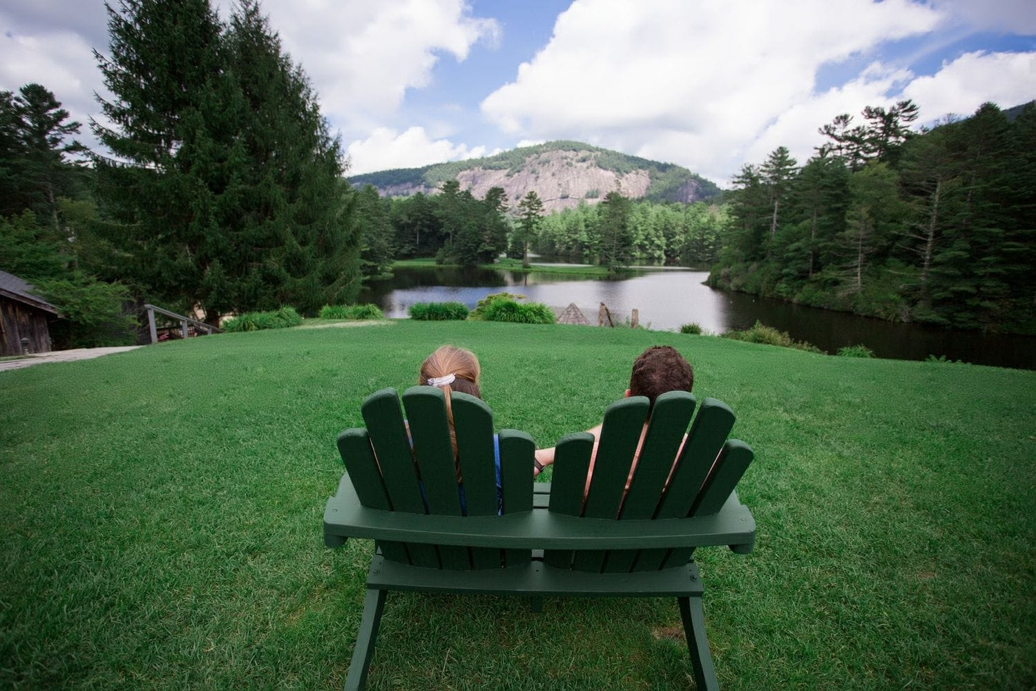 couple relaxing overlooking the mountains and lake in jackson county