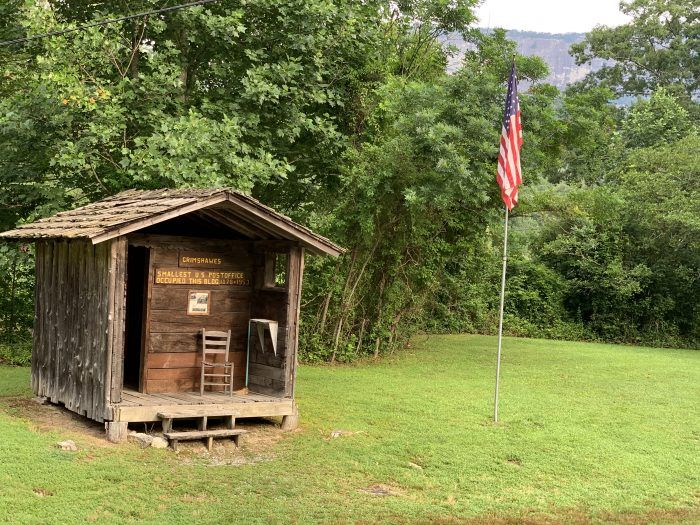 America's Smallest Post office, Grimshawes, under whiteside mountian and US Flag