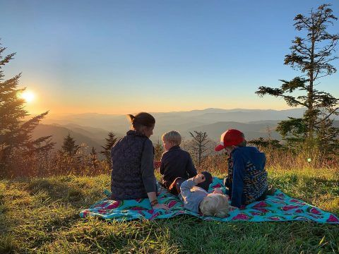 family enjoying a sunset at Waterrock Knob.