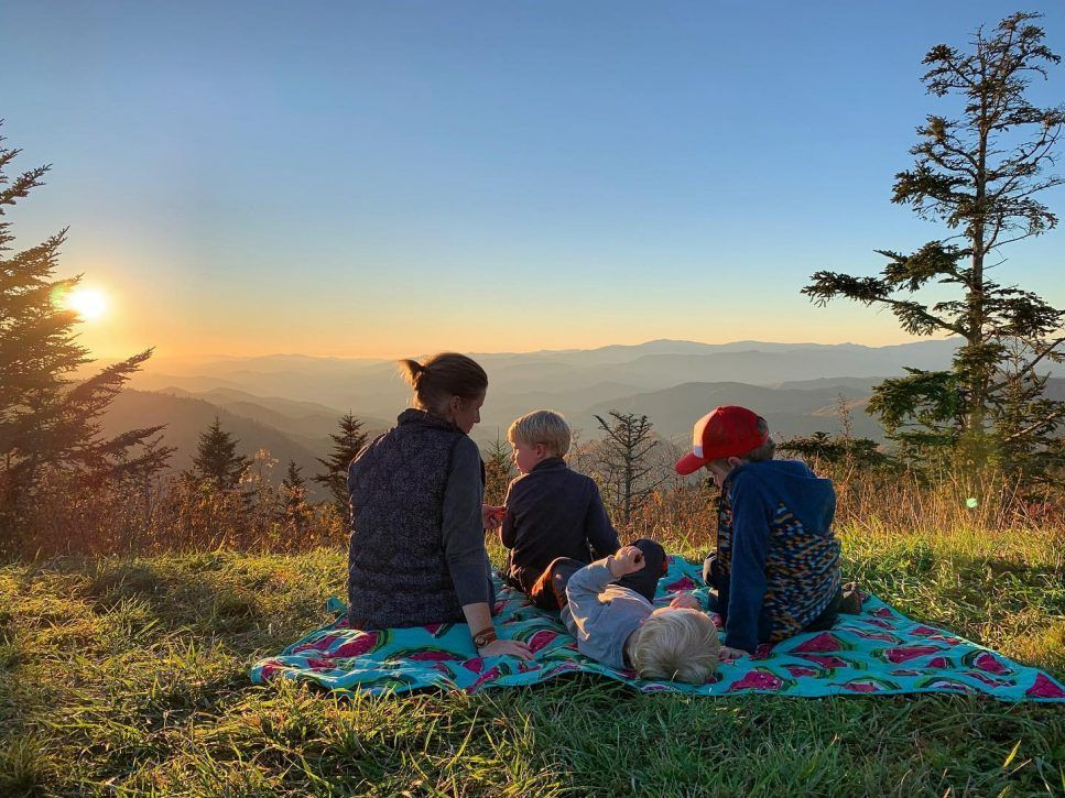 family enjoying a sunset at Waterrock Knob.