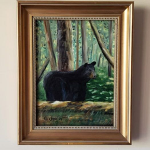 Painting of a bear in the woods.