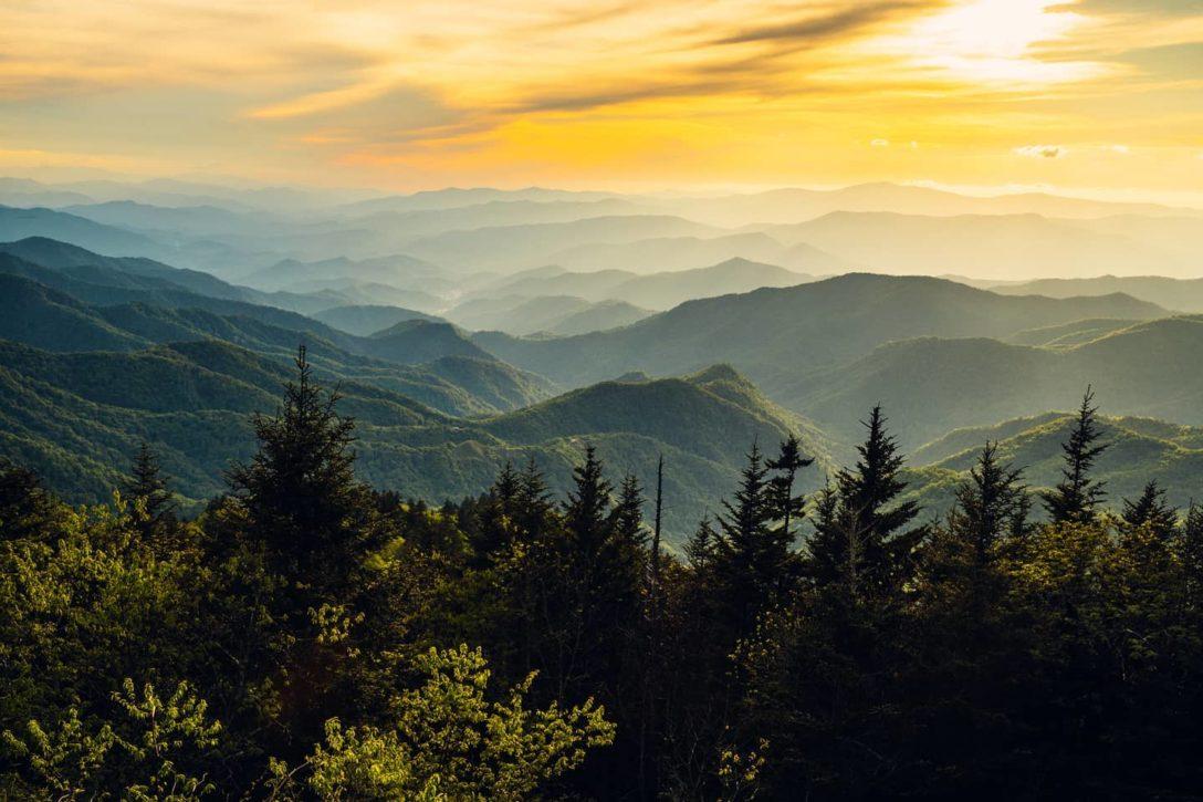 photo of mountain scene during sunset
